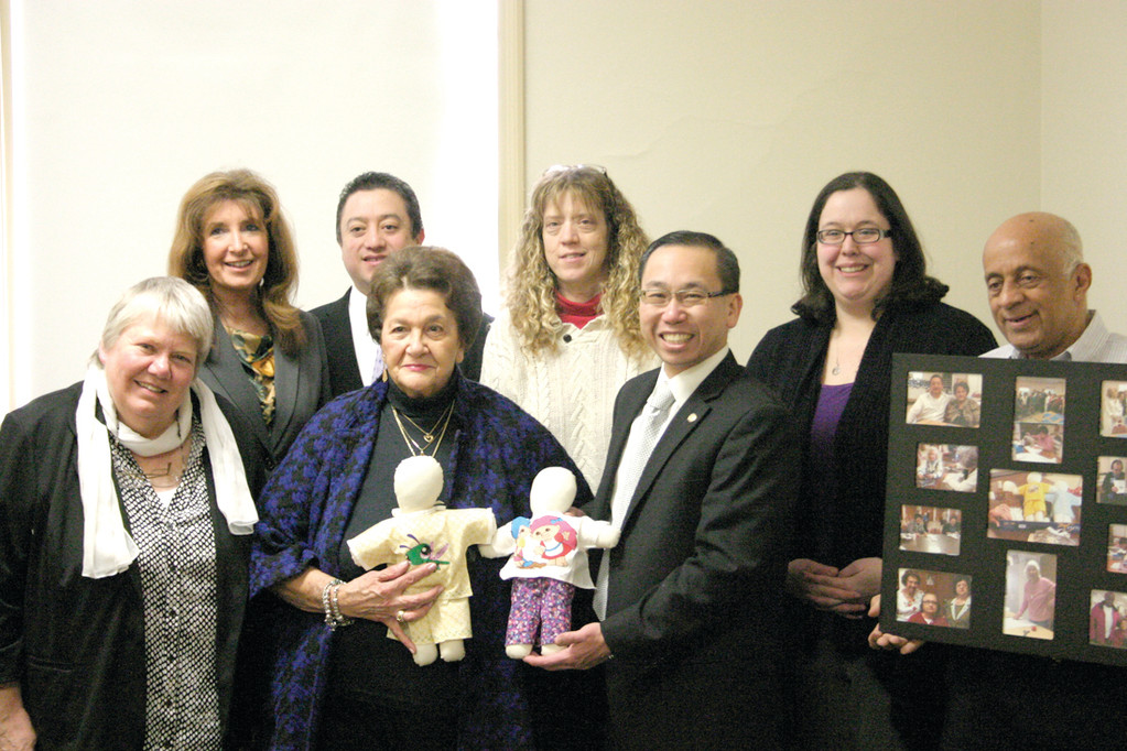 REASON TO SMILE: New Bedford officials visited Cranston recently to celebrate the donation of Smile Dolls by local seniors in December. Pictured, from left, are volunteer Bina Gehres, Cranston Senior Services Executive Director Sue Stenhouse, Cranston RSVP Director David Quiroa, volunteer Ann Tanzi, New Bedford Council on Aging Director Debra Lee, Cranston Mayor Allan Fung, New Bedford Council on Aging Assistant Director Pamela Amaral-Lema and John Lobo, neighborhood liaison for New Bedford�s Department of Community Services.