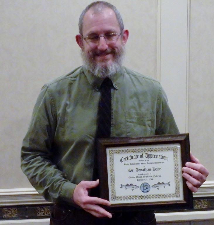Warm water brings warm water fish: Dr. Jonathan Hare, director of NOAA's Narragansett Lab, with a certificate of appreciation from the RI Saltwater Anglers Association he received for the presentation he gave on climate change last week.
