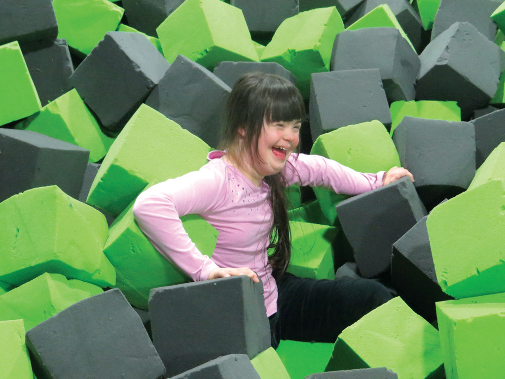 PERFECT LANDING: Emma Beebee, 13, was all smiles after jumping off a trampoline and landing in the popular foam pit.