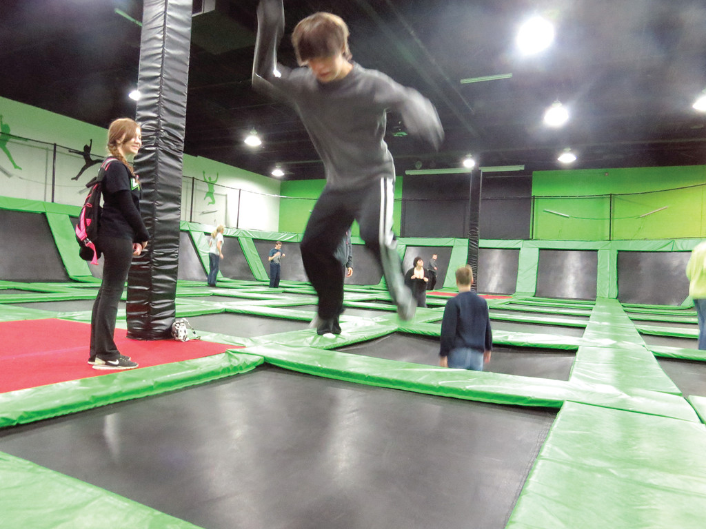 GETTING SOME AIR: Twelve-year-old Sam Miller shows off his jumping skills during Tuesday's Special Needs Day at Launch Trampoline Park.