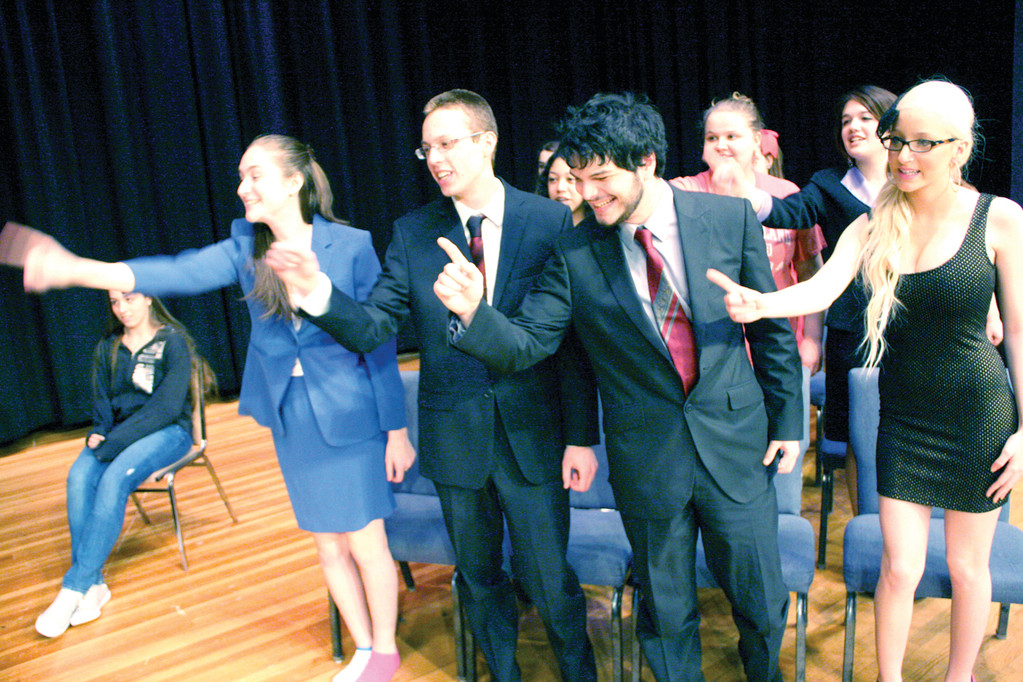 "NOT GUILTY AS CHARGED: Cast members of Toll Gate High School's production of ""Legally Blonde: The Musical"" rehearse the musical number from the show's important court case."