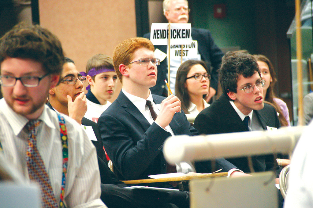 SERIOUS STUFF: Hendricken team members John Andrews and Daniel Mason ponder possible answers during the Super Quiz.