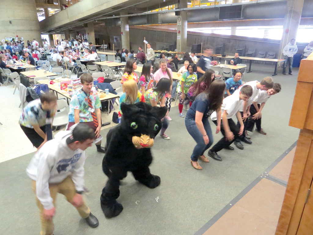 BUST A MOVE: During a break in competition, a number of students joined Johnston High School�s Panther mascot in the �Cha Cha Slide� line dance.