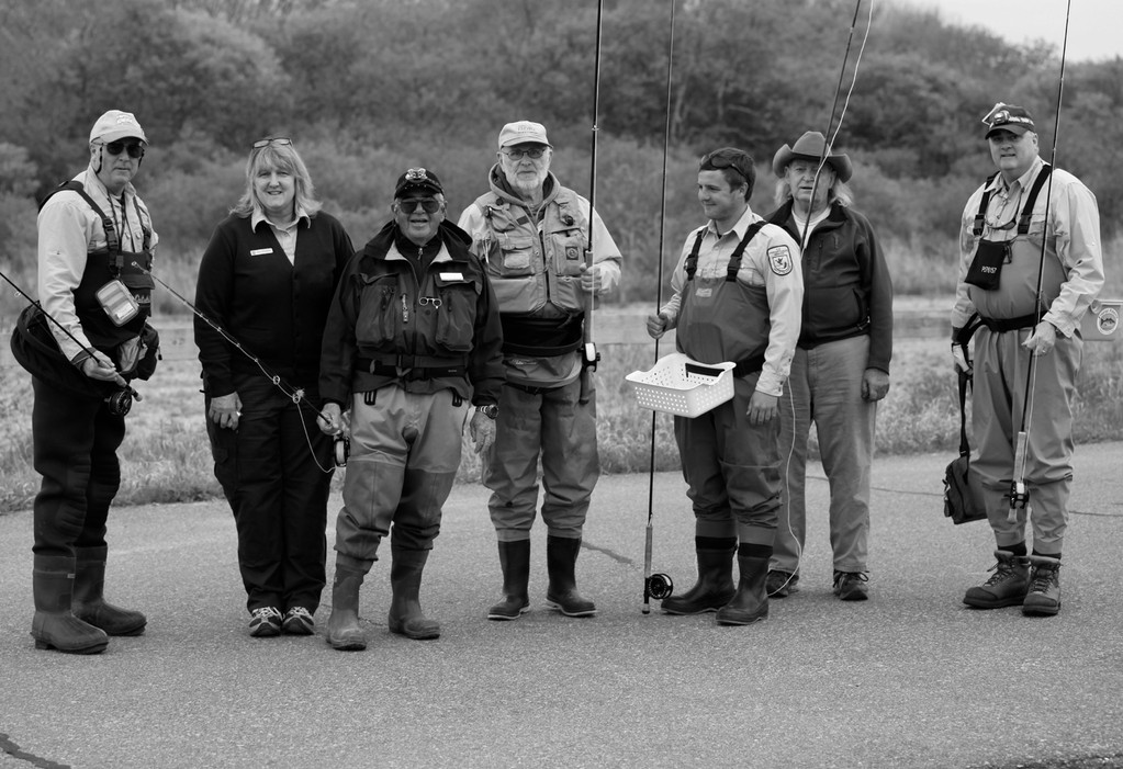 Getting ready to fish: Students, instructors, US Fish & Wildlife Service and DEM officials about to fish with flies made during a cinder worm fly tying and fishing instructional program.