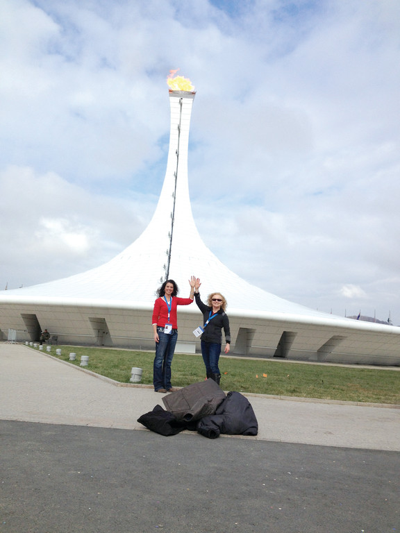 LIGHTING THE TORCH: Botsford (right) and Jessica Sherman, director of physical therapy at the Alpine Clinic in New Hampshire, which serves as the official team physicians of the USA Ski Jumping Team, take advantage of the warm weather in Sochi and pose for a photo with the Olympic Torch in Olympic Park.