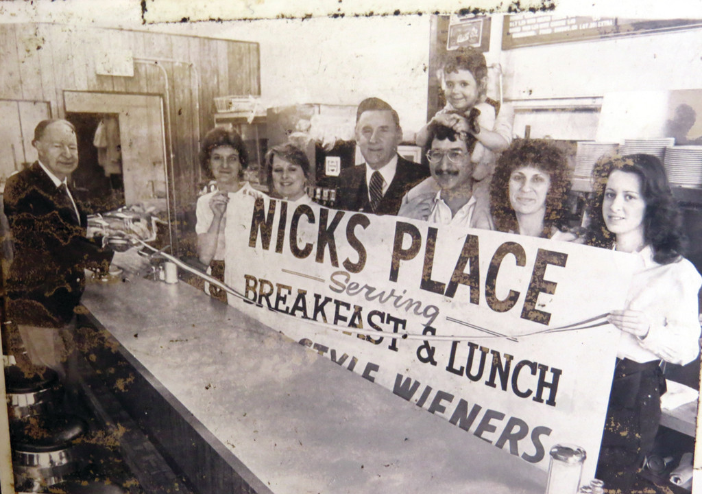 PHOTOS ON THE WALL: In addition to photos of customers lining the wall, Nick Degaitas has photo albums full of photos from the restaurant, including this one from opening day, March 14, 1984.