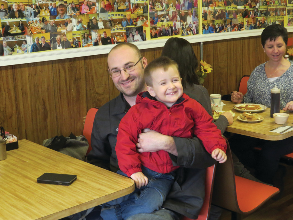 FATHER AND SON: Garrett Molling brings his 3-year-old son Landon to Nick and Joan's whenever he can.