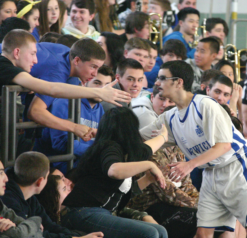 Zach Farrow gets a little love from the crowd before the start of the second half.