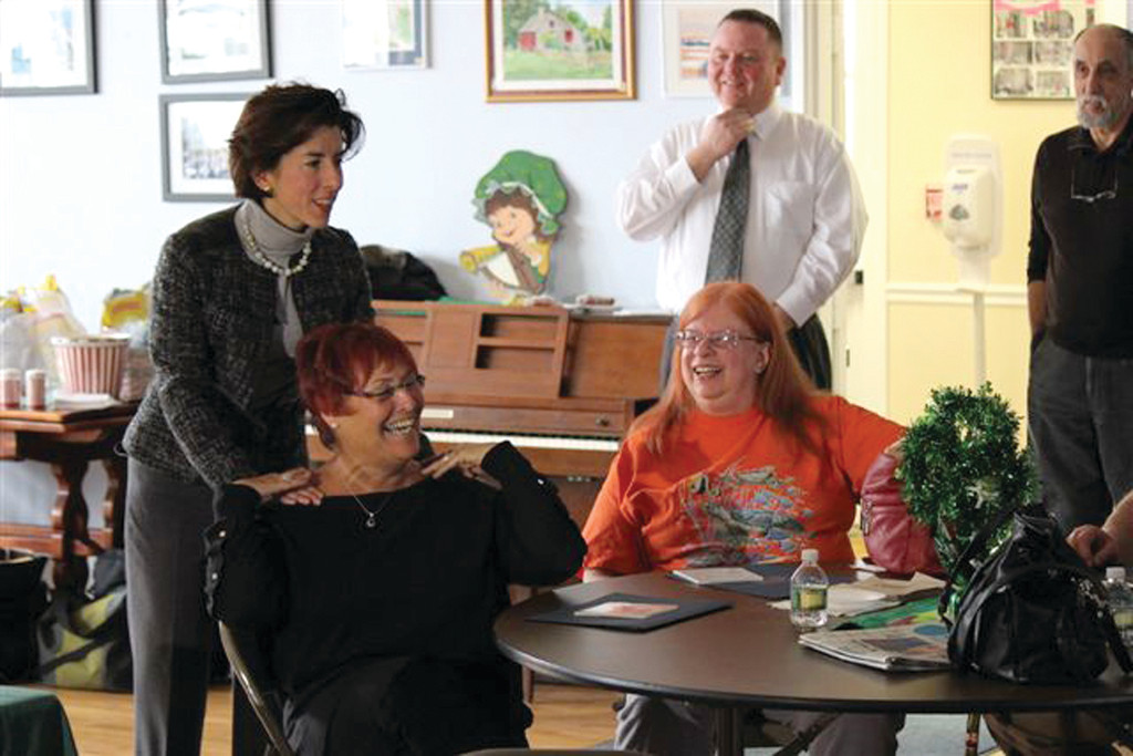 REJOICING: During a recent visit to the Middletown Senior Center, General Treasurer Gina Raimondo joined Sharon Finn of Cranston and Maureen King of Warwick to talk about the Treasury's Unclaimed Property Division.