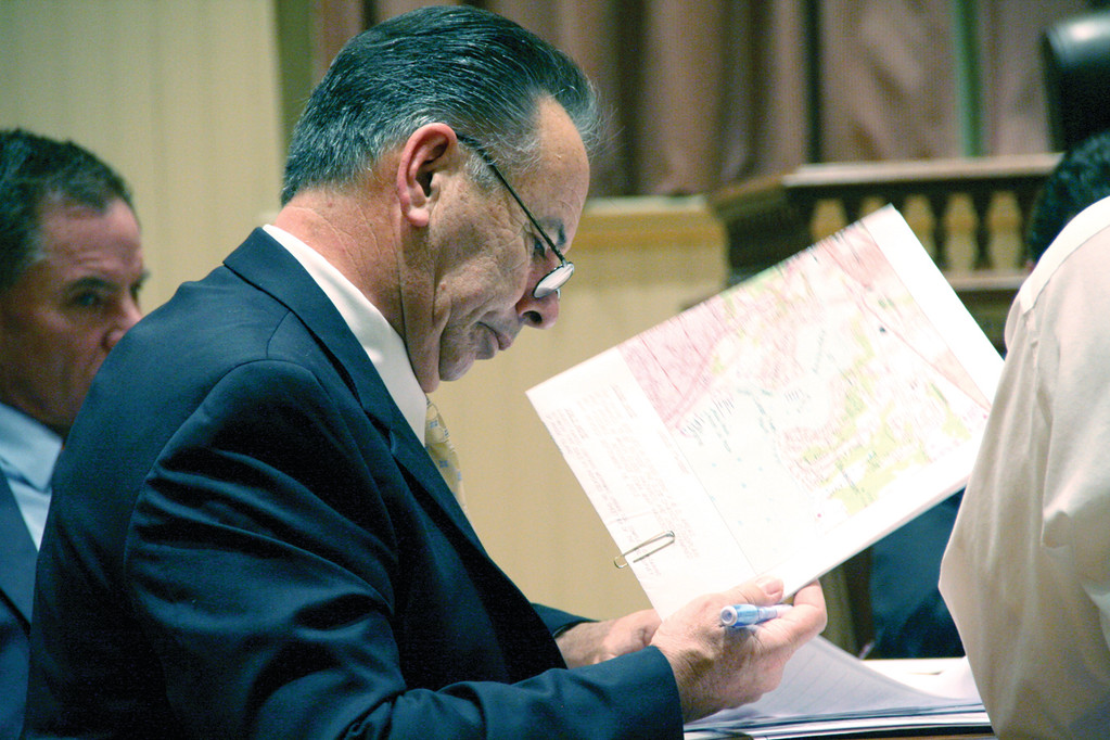 CHECKING THE MAPS: Zoning Board member Everett O'Donnell looks through the application of one of the petitioners appearing before the board Tuesday night.