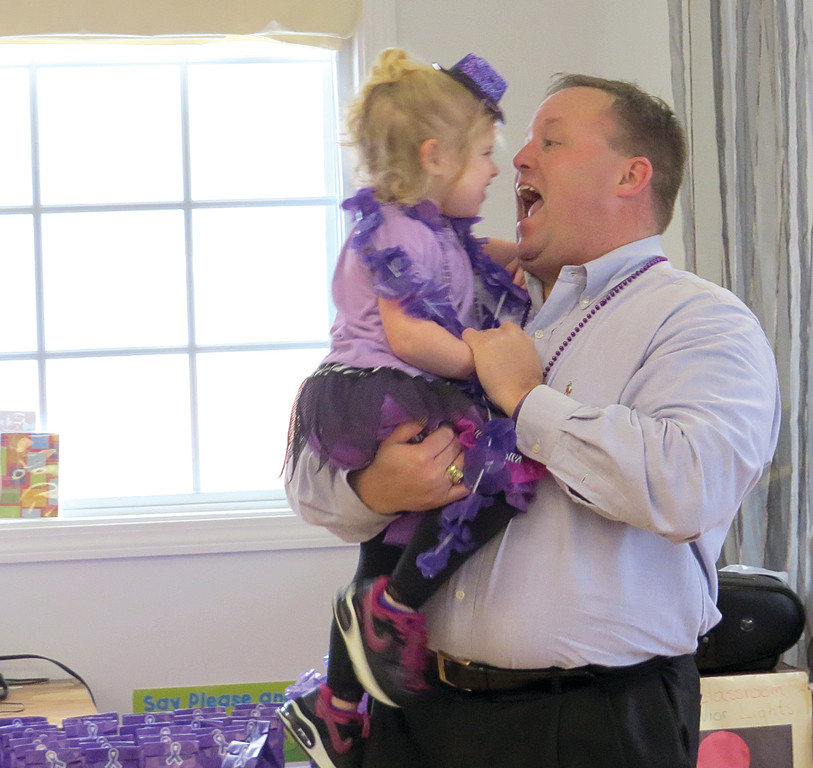 FATHER-DAUGHTER DANCE: Emily Vecchio takes a spin on the floor with her father Philip during The Learning Garden's Dance-A-Thon. Four-year-old Emily is living with epilepsy, and the school hosted the fundraiser in her honor.