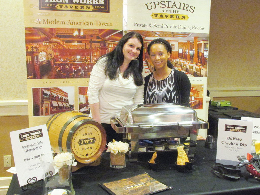 SOMETHING SPECIAL: Iron Works' Erica Flanagan and Jasmine Huff serve buffalo cheese dip during the Rotary Club of Warwick's fourth annual Gourmet Gala last Wednesday night.