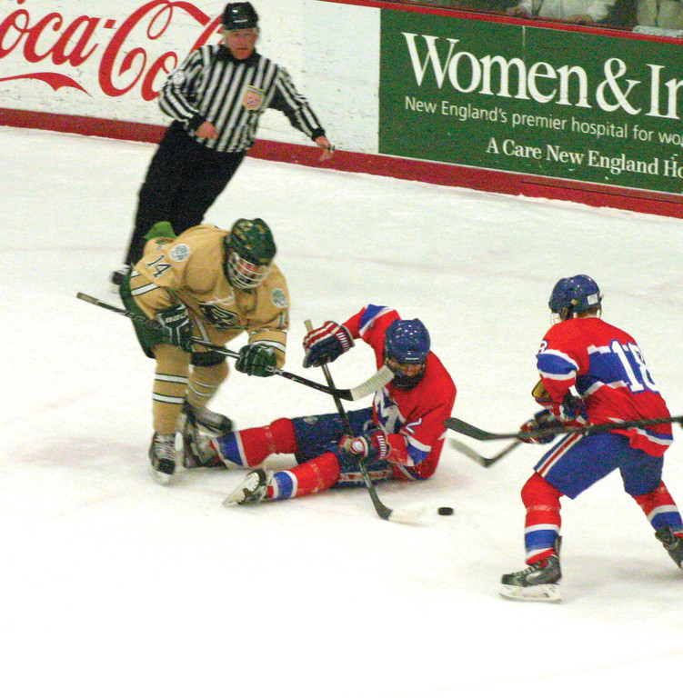 HAVE A SEAT: Hendricken�s Josh Olson tries to get to the puck as Mount�s Justin D�Abrosca tries to control it from the ice in game one of the state hockey championship.