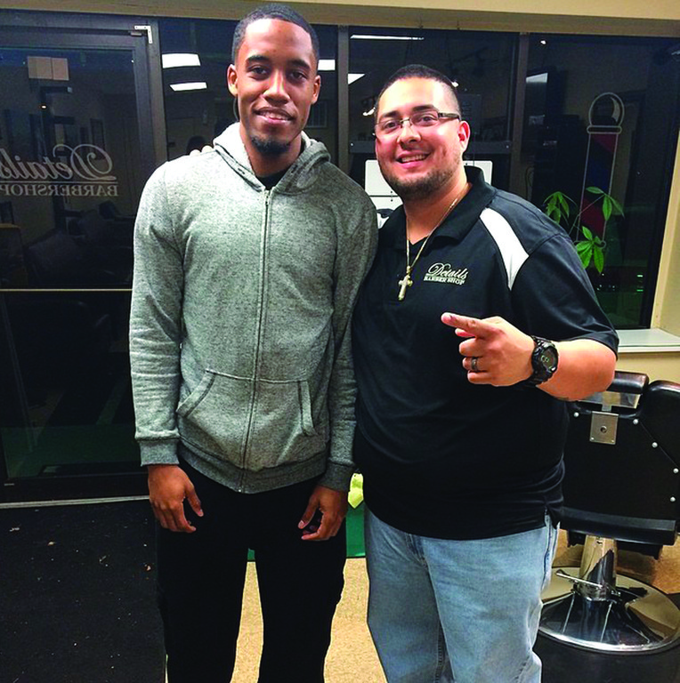 ALL AMERICAN HAIR: Cranston barber Manny Garcia has been cutting the hair of Providence College Star Bryce Cotton for four years. Cotton leads the Friars into the NCAA Tournament this week.