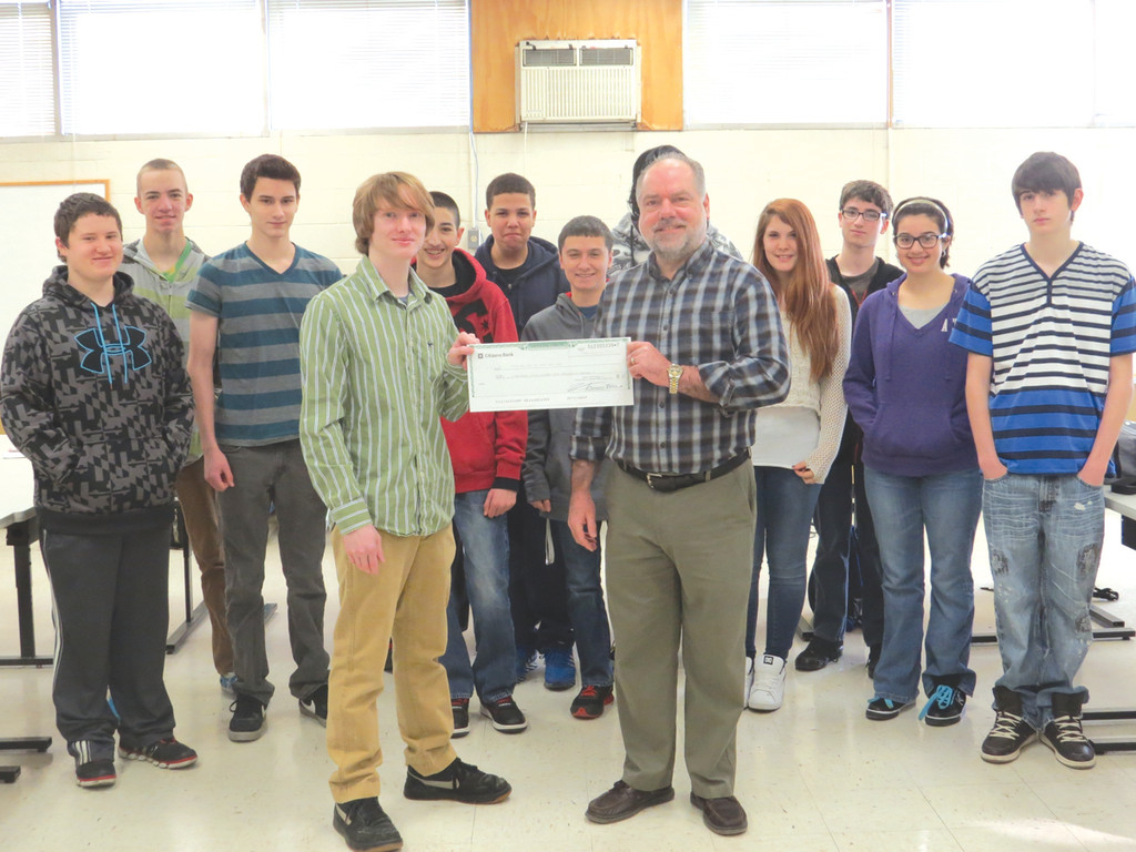 GIVING BACK: 2011 graduate of the Electronics program at Warwick Area Career and Technical Center Arthur Bradford donated $1,000 to the program. Teacher Real Carpenter said the money would go toward purchasing micro-controllers and additional components to enhance the curriculum.
