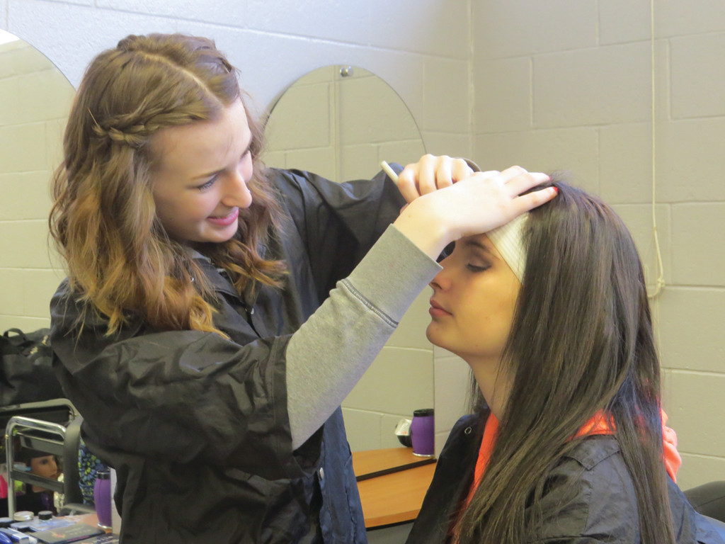 HAIR, NAILS & MAKE-UP: Getting their make-up, hair and nails done on a daily basis is an added bonus for the students in Warwick's cosmetology program. Above, Katie Morrison applies a night make-up style to her classmate Adrianna Courtney.
