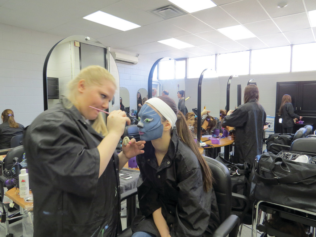 "OUT OF THIS WORLD STYLE: In preparation for Friday's SkillsUSA competition, McKenzie Ford practices her ""Avatar""-inspired fantasy make-up design on Maeghan Dufour."