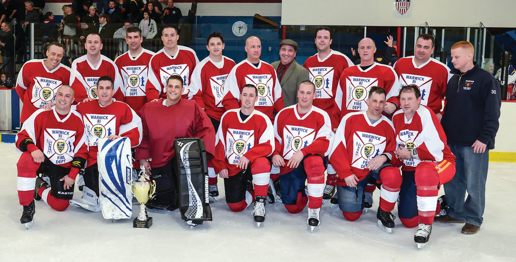 WINNER, WINNER: The Warwick Fire Department hockey team poses for a picture after defeating the Police Department in last year's Mayor Cup. The two sides are ready to put it on the line again this year for the second annual match-up.