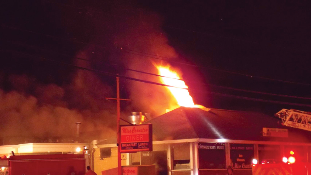 LANDMARK BURNS: Flames shoot from the roof of the iconic Miss Cranston Diner on Oaklawn Avenue in Cranston early on the morning of March 21.