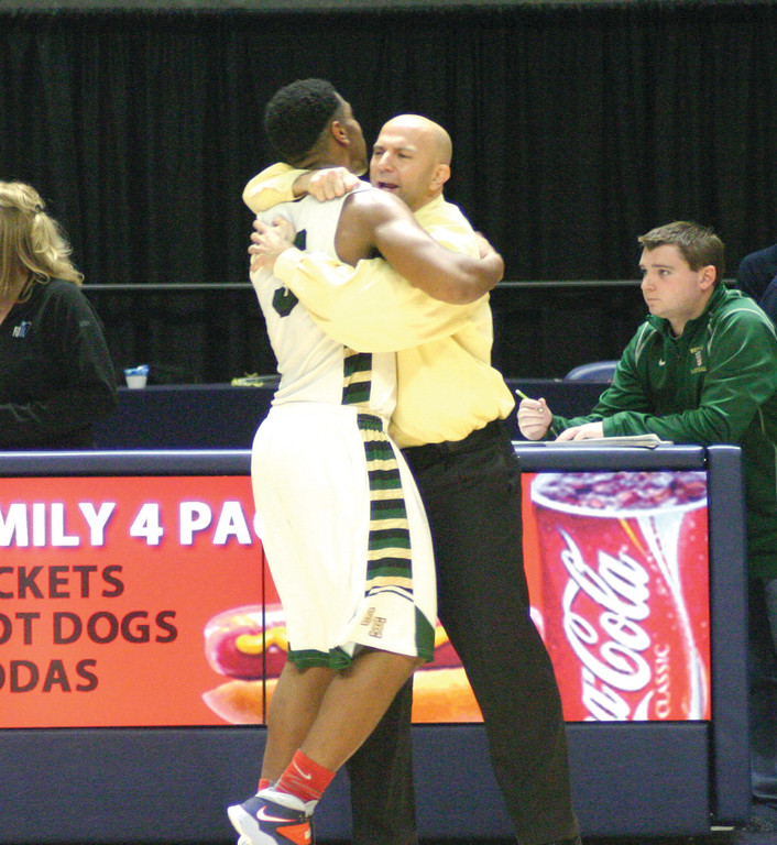 CHAMPIONSHIP MOMENT: Hendricken senior Garfield Coustard and head coach Jamal Gomes share a hug in the final minutes of Hendricken�s state championship victory on Saturday.