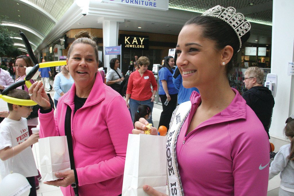 IN SUPPORT OF THE CAUSE: Karen Maggiacomo and her daughter Gabriella, Miss RI Teen USA of Hope, take a popcorn break during their circuit around the mall.