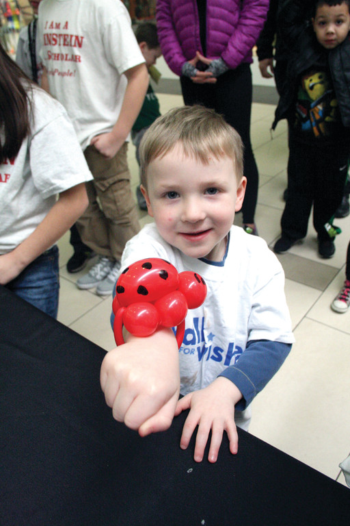 BALLOON BRACELET: Riley Flamand, 4, proudly displays the balloon bracelet he received.