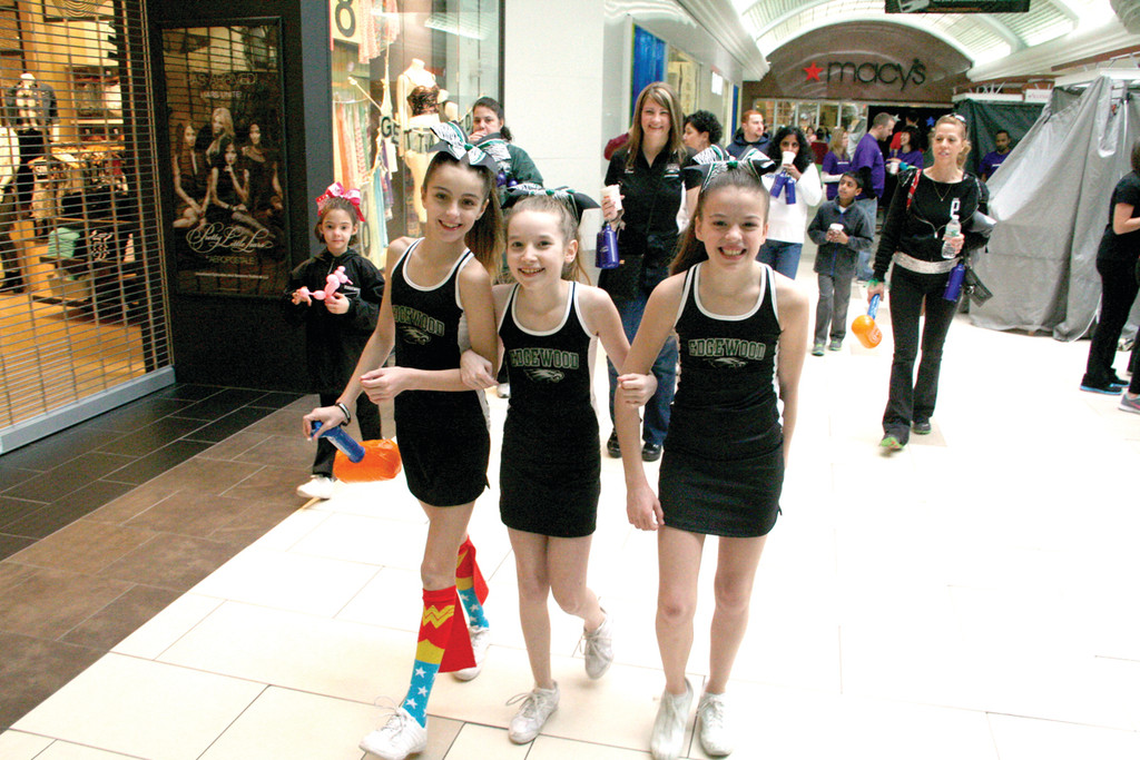 ON THE MARCH TO GRANT WISHES: Edgewood Eagles national champion cheerleaders were one of many teams to participate in Sunday�s event. They raised about $800 for the cause, and did a cheer for all walkers. Pictured are Maggie Carr, Makenna Paugh and Hannah Sasa.