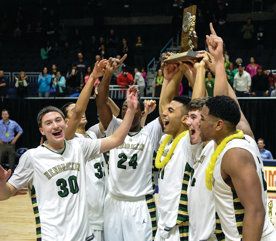 HOLDING IT HIGH: Hendricken players show off the championship trophy.