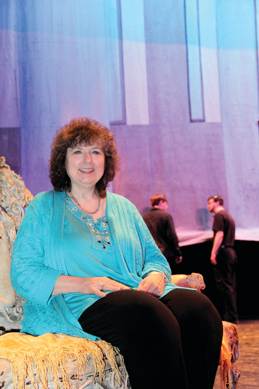 Cranston resident and composer Noreen Inglesi sits on the set of The State Ballet of Rhode Island's new production called Cowboys, Cadets & Collaborative Works. Inglesi's music is featured in two of the ballet's acts.