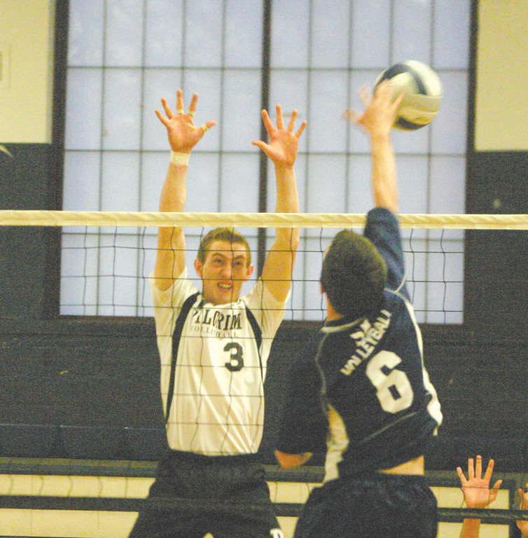 TOP TIER: Pilgrim's Caleb Fournier rises for a block against eventual state runner-up South Kingstown last year. The Patriots are set to begin their second season in Division I and are keeping expectations high.
