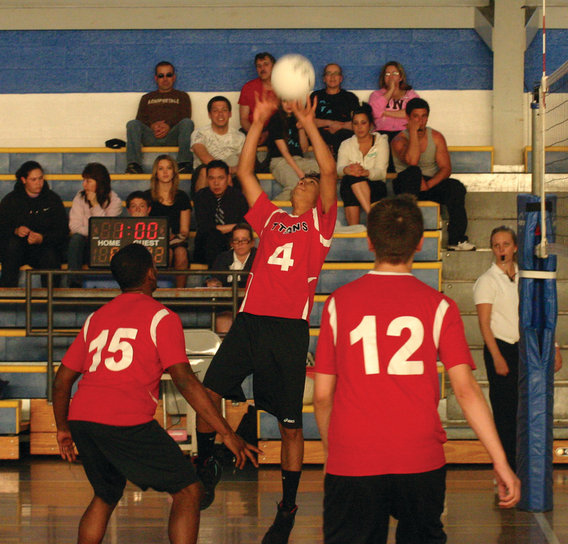 MAKING THE PASS: Jose Beltran, one of a handful of returners for the Toll Gate volleyball team this year, sets a ball into the air during a game last season.
