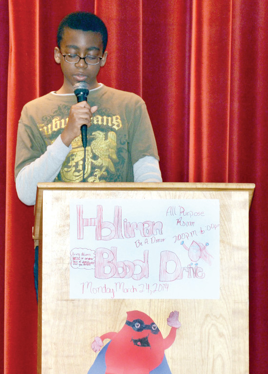 COMPELLING ESSAY: Temitope Olrainde reads his essay at Monday's blood drive at Holliman School.