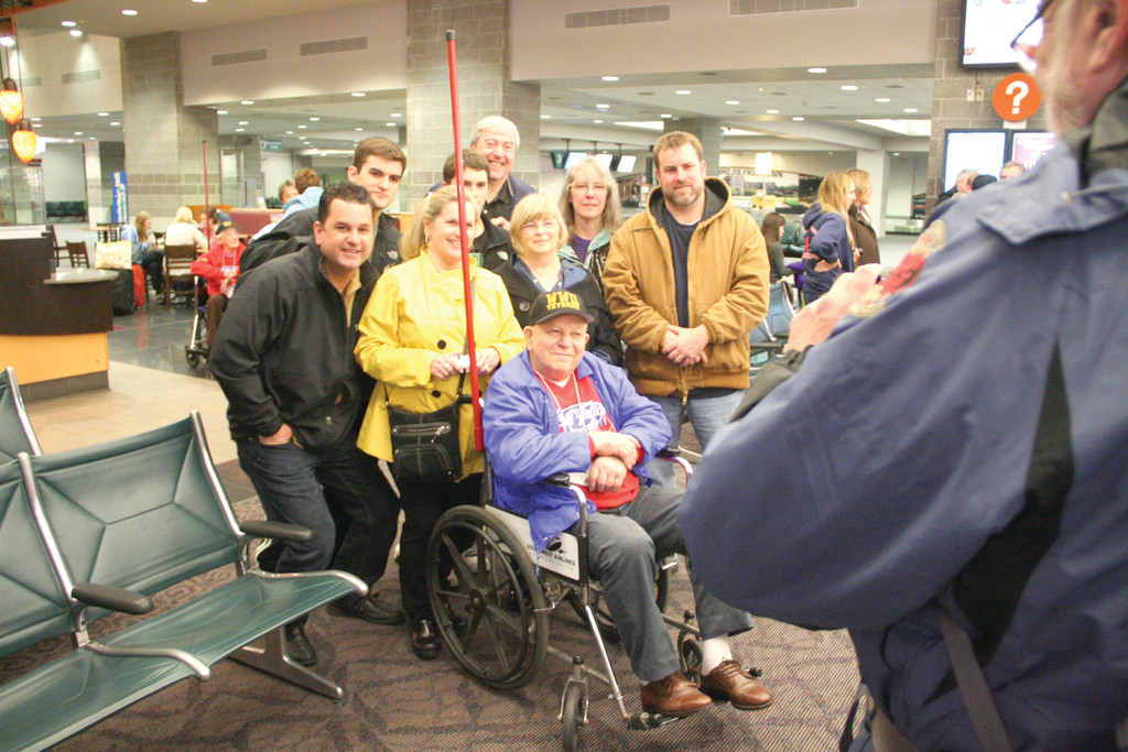 A HERO'S WELCOME: WWII Navy veteran James Loftin, who will never forget the action he saw during amphibious landings in North Africa and Europe, was met at Green Airport by a large contingent of family.