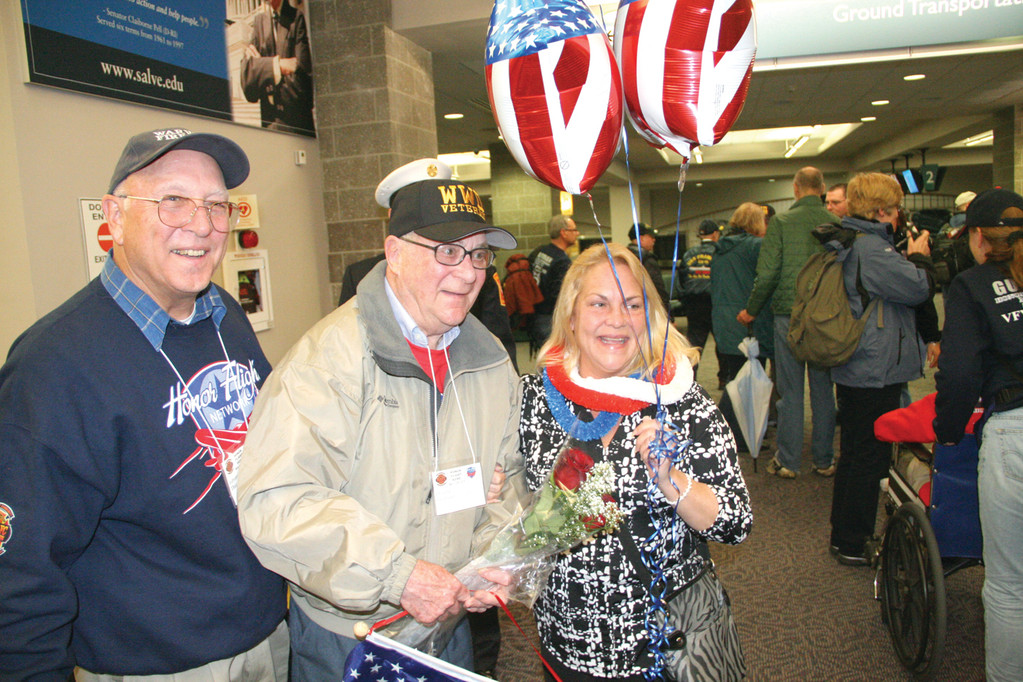 AN EMOTIONAL EXPERIENCE: WWII veteran Donald Thornton, flanked by his guardian Ed Thurston and daughter Beth Gauthier, said he was especially moved by the greeting they received at Green Airport and when they arrived in Baltimore.