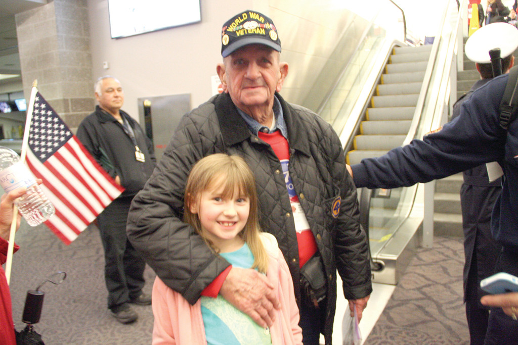 GRANDPA'S BACK: Talia Dinwoodie stayed up late Saturday to welcome home her great-grandfather, Robert Morgan. Morgan was one of 22 WWII veterans who participated in Saturday's Honor Flight.