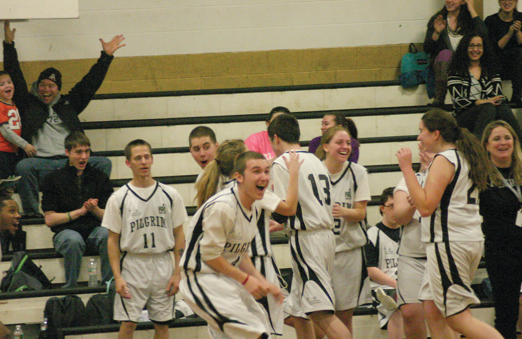 WOW: Pilgrim players and fans react to Adam Bisard's halfcourt  shot at the end of Wednesday's unified basketball game between the Pats and Hendricken.