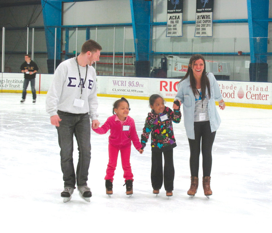 STUDENTS PITCH IN: University of Rhode Island students played a huge role in the success of Saturday's BBBSOS ice skating party in Kingston, and even took the ice to make sure each child enjoyed their time during the two-hour event.