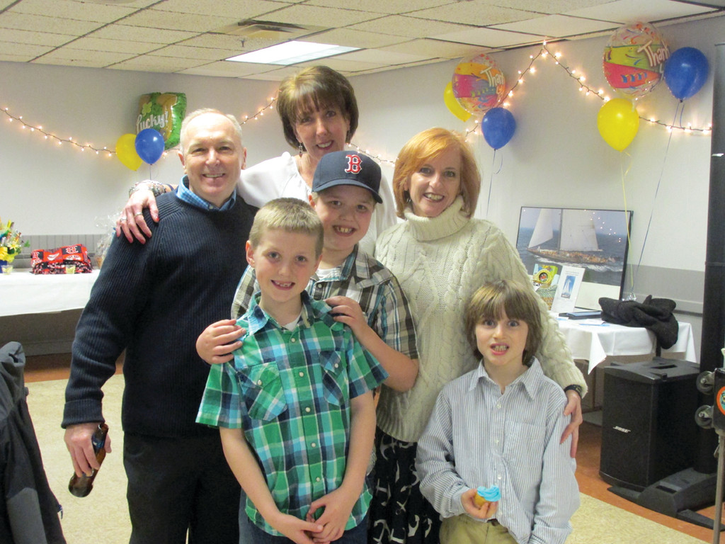 LOTS OF HELP: Chris Murphy (center top) is joined by David and Trish Boisvert of Sailing Heals and her grandchildren, Grant, Carter and Sebastien, during last Saturday's extraordinary fundraiser that will result in $7,000 for the non-profit that helps cancer patients escape for a day at sea.