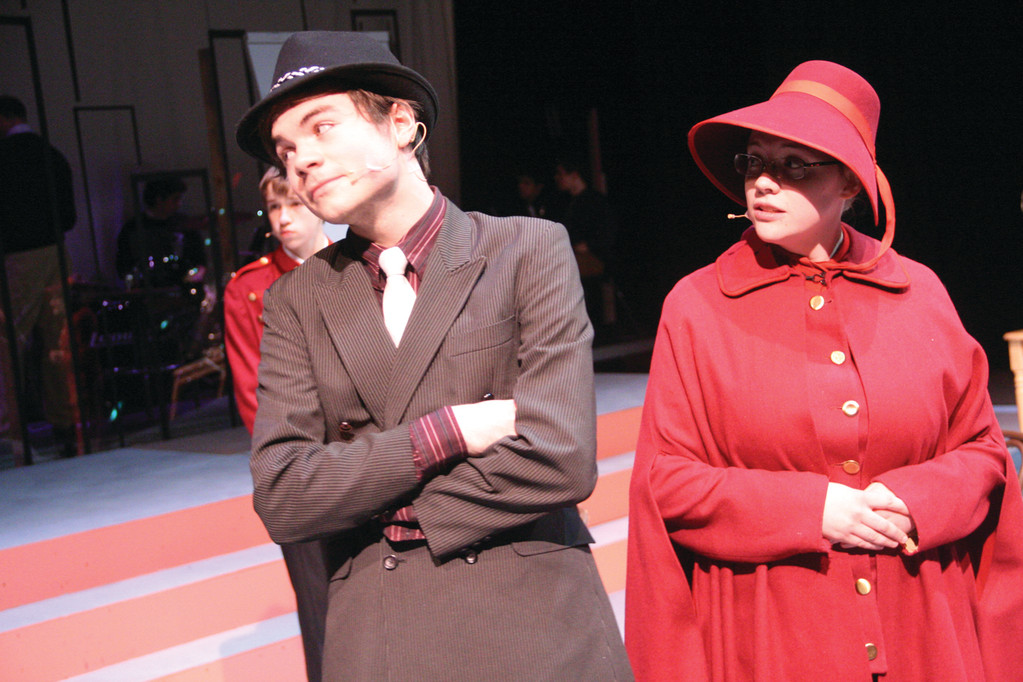 "SEEING EYE TO EYE? Gambler Sky Masterson, portrayed by Dane Granja, and General Cartwright, portrayed by Emily McCarthy, appear to be at odds in ""Guys And Dolls."""