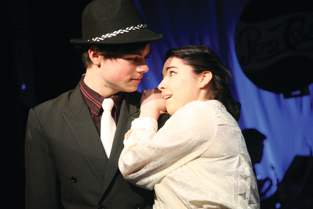 "FINDING THE RIGHT GUY: Dane Granja and Michelle Houle play Sky and Sarah, one of two couples at the center of the action in ""Guys And Dolls."""