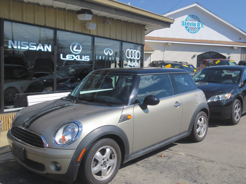 Looking for the perfect graduation gift? Come test drive this gold, standard 2009 Mini-Cooper, now available for $8,999 at Stevie D's on Oakland Avenue.