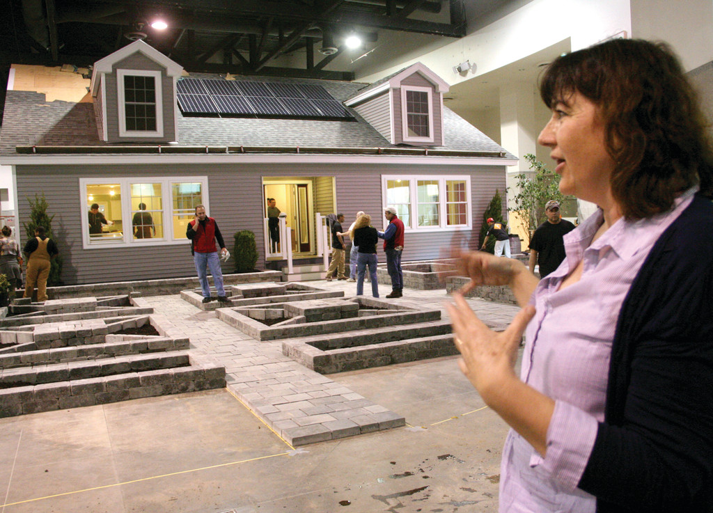 WOW FACTOR: Shannon Brawley, executive director of Rhode Island Nursery and Landscape Association, looks over the 2,000-square-foot house manufactured by Maine-based KBS Building Systems.