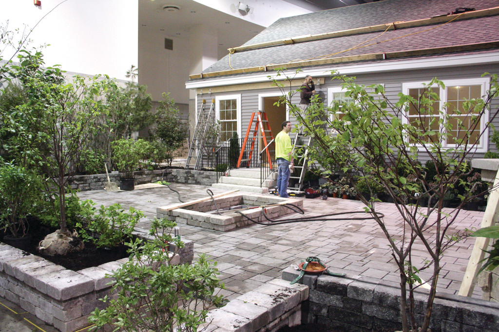 WOODSY BACKYARD: The backyard is being designed to be an outdoor living room complete with fireplace, which also serves as a stone pizza oven, and a hot tub. Yet, the plantings are designed to also offer forage for wildlife.