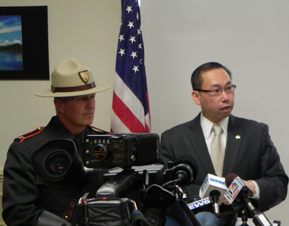 Cranston Mayor Allan Fung addresses members of the media as State Police Col. Steven O'Donnell looks on, Thursday.