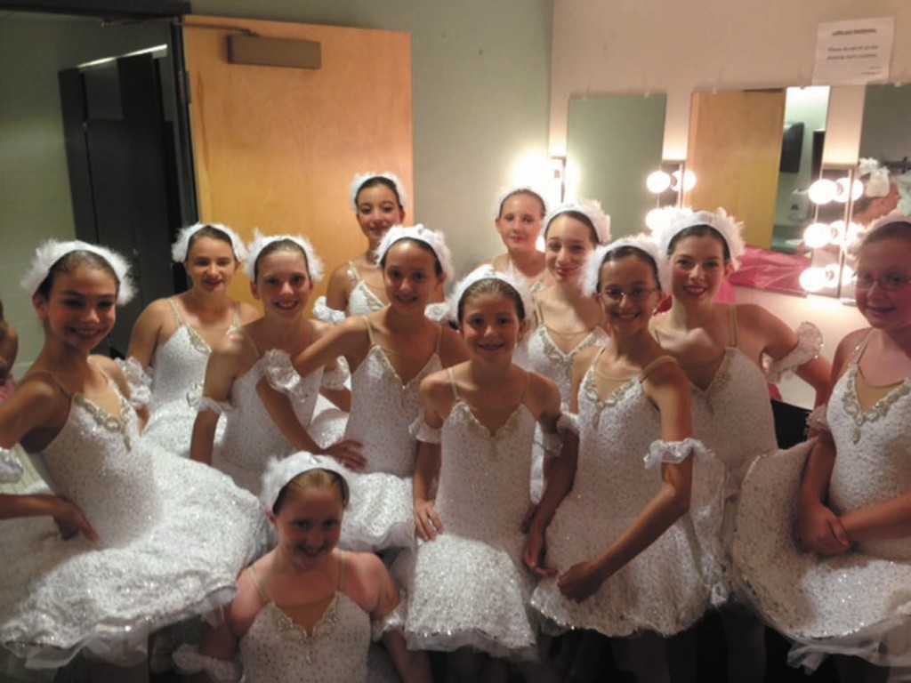 A bevy of smiling dancers, adorned in their beautiful tutus are ready to leap at To The Pointe of Performing Arts studio in Cranston.