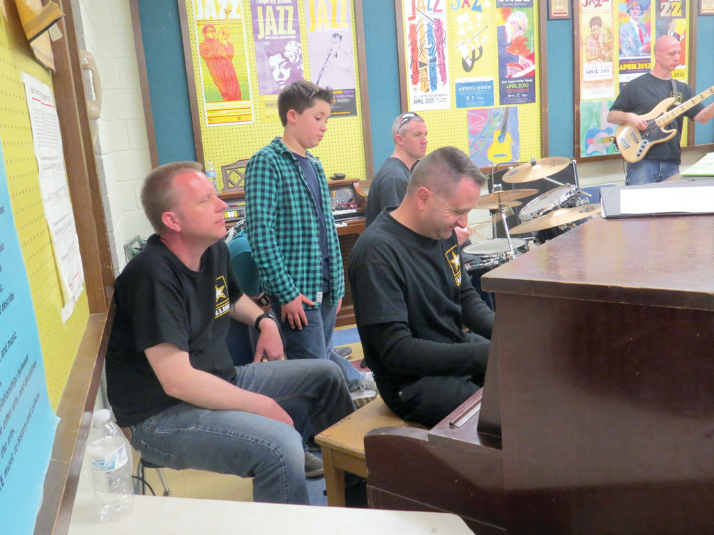 SITTING IN: SSG Brandon Boron, MSG John Lamirande, SSG Glenn Robertson and SFC Peter Krasulski took over the instruments from some of Winman's Jazz Band players, including pianist David Yabut, to show them how to play a simple blues tune.