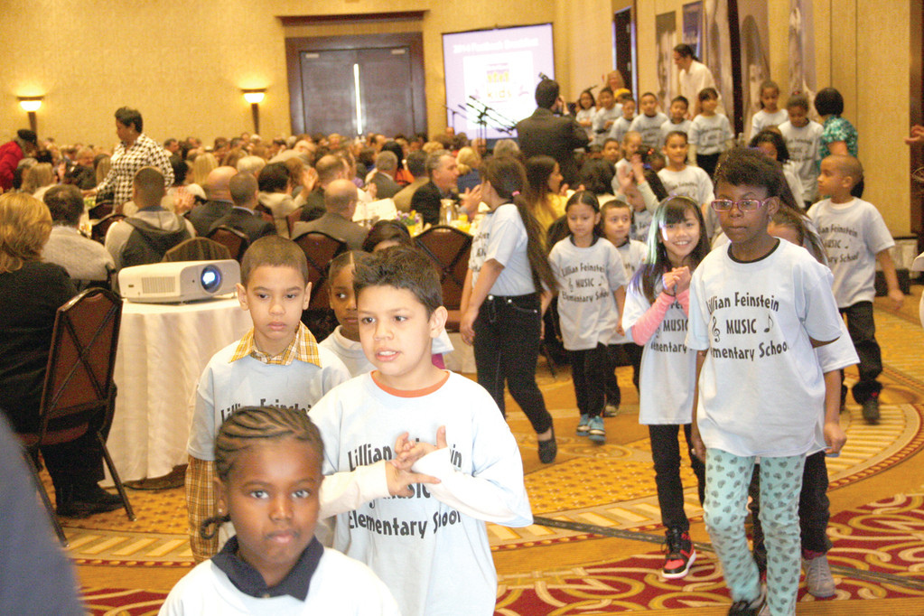 KIDS' TOUCH: A junior chorus of first- and second-graders from the Lillian Feinstein/Sackett Street School leave the grand ballroom at the Crowne Plaza after performing two songs at Monday's release of the 2014 KIDS COUNT Factbook.