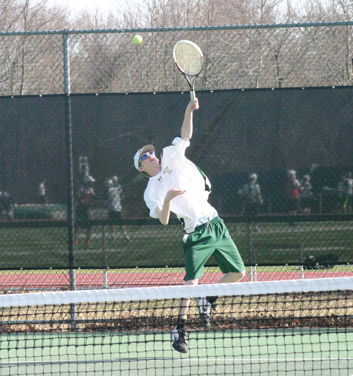 OVER THE TOP: Hendricken's Christian Boyer serves the ball at No. 1 singles on Thursday.