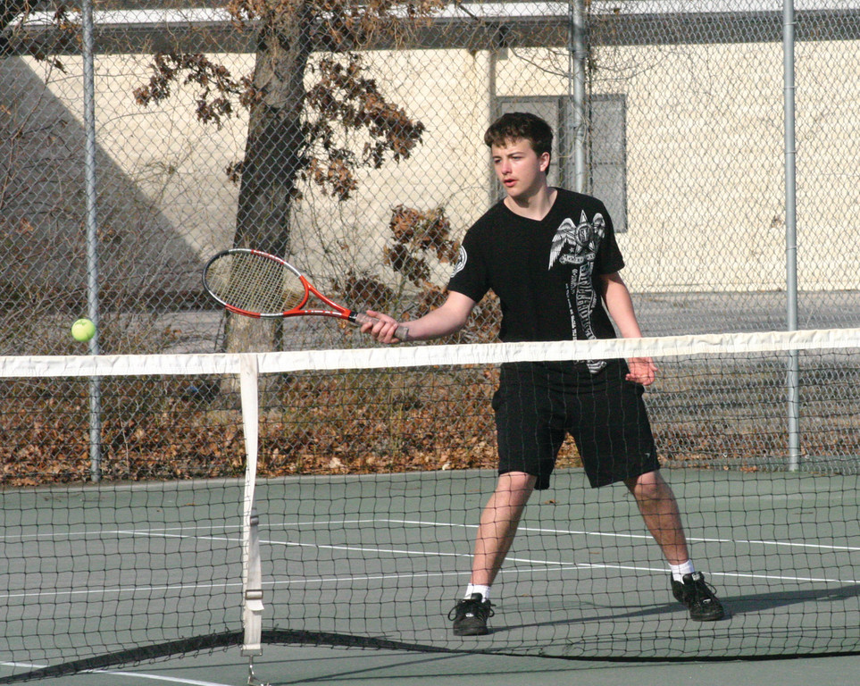 GIVING IT A GO: Pilgrim's Corey Packingham reaches his racket for a ball at the net during Thursday's match with Classical. Packingham is one of three players new to the sport on the Pilgrim roster.
