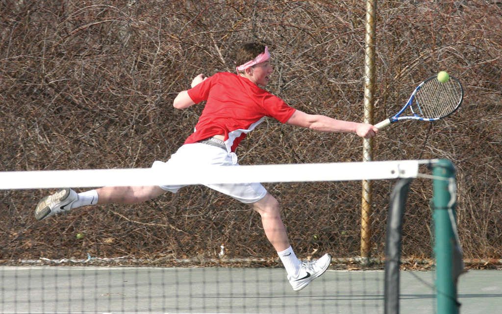 BACK STRETCH: Toll Gate's Dan Smith stretches to get to a shot during Thursday's season-opening match against Prout. Smith is one of several returning players looking to push the Titans into contention in their second year back in Division II.
